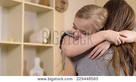 Little Girl Firmly And With Love Hugging Her Mother, Warm Relations, Childhood, Stock Footage