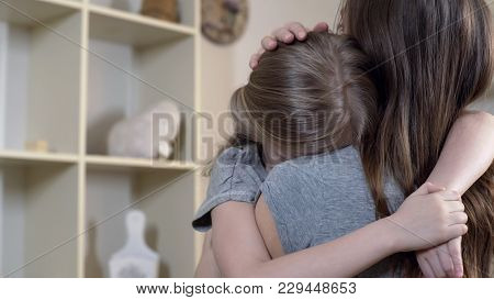 Woman Comforting Her Upset Or Sick Child Carefully, Mother Hugging Sad Daughter, Stock Footage
