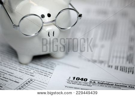 US Tax forms with piggybank