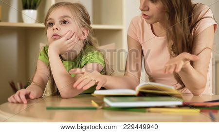 Annoyed Woman Hopelessly Teaching Little Girl, Naughty Daughter Ignoring Mother, Stock Footage