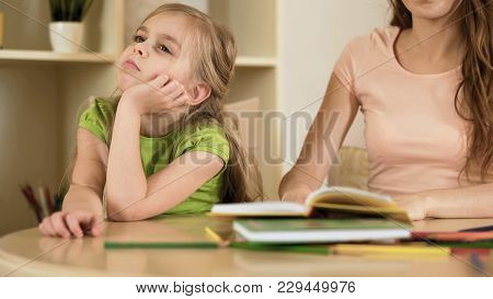 Sensitive Mother Hopelessly Explaining Homework To Naughty Daughter, Disregard, Stock Footage
