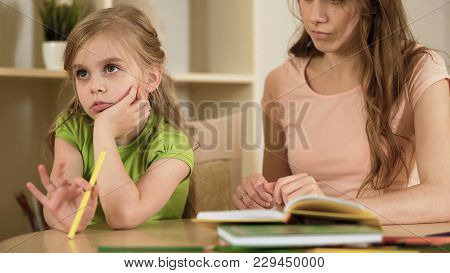 Little Daughter Ignoring Mother Making Her To Do Homework, Homeschooling, Stock Footage