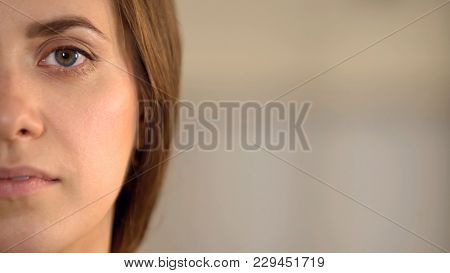 Young Female Half Face Looking Into Camera, Average Woman Opinion Statistics, Stock Footage