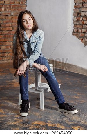 Beautiful Stylish Hipster Girl Sitting Chair, Looking Camera. Attractive Teenager Brunette Fashion P