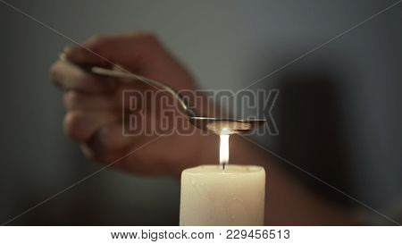 Hand Of Person Heating Chemical Substance In Spoon On Candle Light, Drug Abuse, Stock Footage