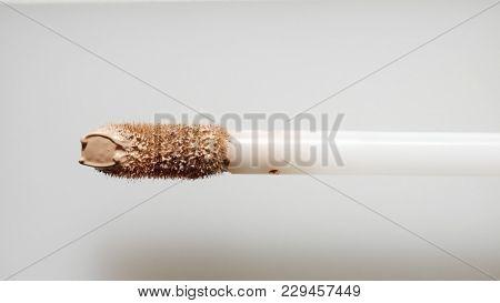 Facial Corrector With Stick. Top View Corrector Smudge Texture Of Corrector. Macro Makeup Texture