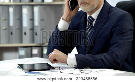 Male Company Director Dialing, Talking Cell Phone, Tablet And Glasses On Table, Stock Footage
