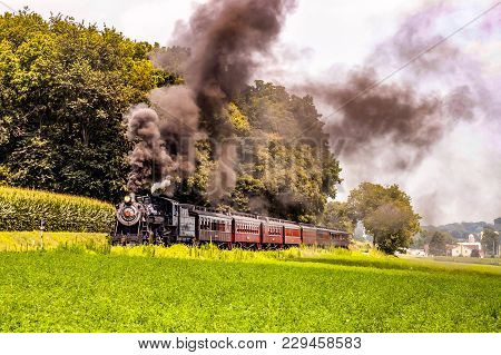 Passenger Steam Train Waiting For Passengers On A Summer Day