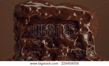 Chocolate Cake With Chocolte Cream With Different Texture. With Liquid Chocolate Pouring On It