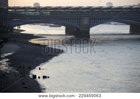 View Of The Thames At Dusk. Low Tide