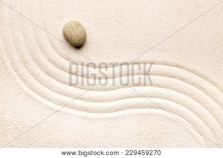 Zen sand and stone garden with raked curved lines. Simplicity, concentration or calmness abstract concept. Top view. poster