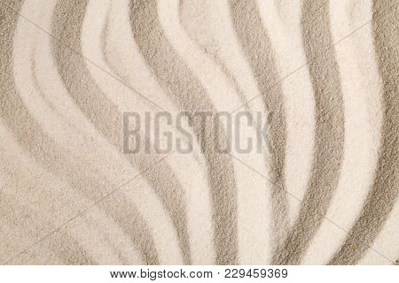Zen sand garden with raked curved lines. Simplicity, concentration or calmness abstract concept. Top view. poster