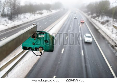 Winter Snowy Day View Of Average Speed Traffic Camera Over Uk Motorway.