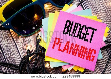 Word, Writing Budget Planning. Business Concept For Financial Budgeting Written On Old Wood Wooden B