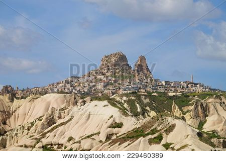 Wide Angle Of Uchisar City On The Hill At Daytime With Cloudy Blue Sky In Cappadocia, Turkey