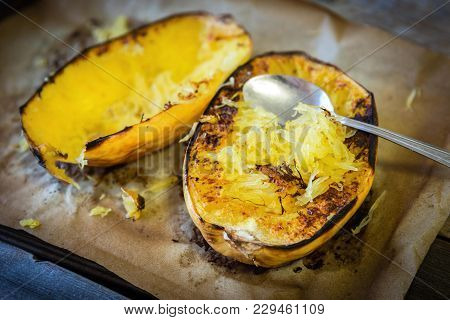 Horizontal Image Of Fresh Roasted Yellow Spaghetti Squash Lying On Brown Roasting Paper In Shallow P