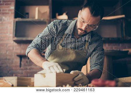 Handsome Gifted Hardworking Confident Concentrated Bearded Handyman Clothed In Checkered Shirt Apron