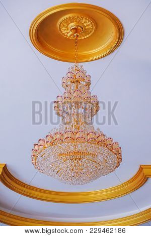 Elegant Crystal Chandelier On The  Background Old