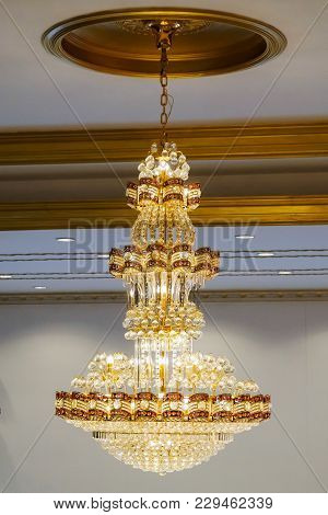 Elegant Crystal Chandelier On The Background Antique