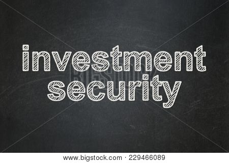 Security Concept: Text Investment Security On Black Chalkboard Background