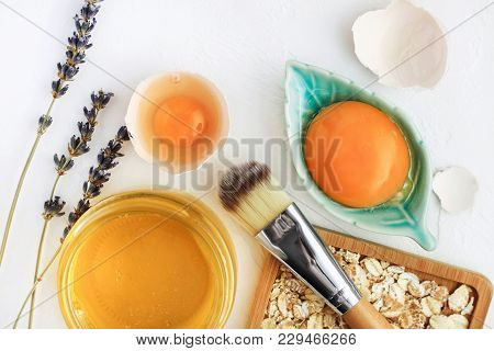 Bright Egg Yolks, Oatflakes, Honey, Lavender With Cosmetic Brush Closeup, Natural Holistic Ingredien