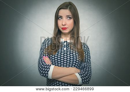 Serious Offended And Disappointed Woman Is Thinking Isolated On Gray Background.