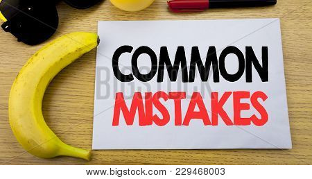 Common Mistakes. Business Concept For Common Concept Written On Note Empty Paper, Wooden Background