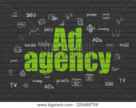 Advertising Concept: Painted Green Text Ad Agency On Black Brick Wall Background With  Hand Drawn Ma