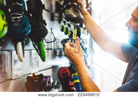 Assortment Roller Skates Isolated In Store Shop, Person Choosing And Buy Color Roller-skates On Back