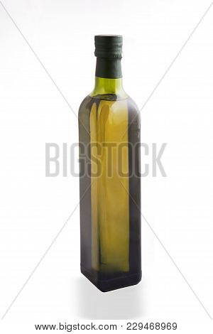 Olive Oil In The Bottle Isolated On White Background