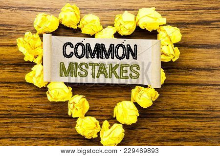 Word, Writing Common Mistakes. Business Concept For Common Concept Written On Sticky Note Paper On D