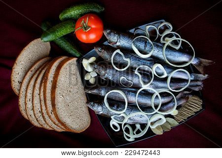 Salted River Fish Served With Bread, Tomatoes, Spices And Onions. The View From The Top.