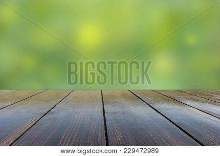 Wooden Board Empty Table In Front Of Blurred Background. Old Wooden Stand With View Of Blurred Backg