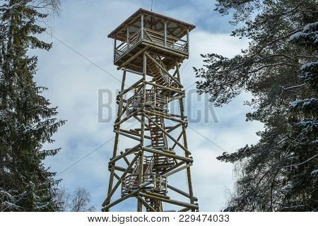 Wooden Watch Tower For Tourists To Observe The Surrounding Landscape In Winter Forest