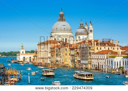 Venice, Italy. Scenic View Of The Grand Canal With Basilica Santa Maria Della Salute And Tourist Boa