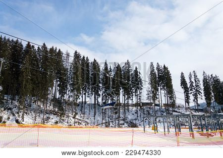 Side View Of The Ski Slope And Working Chairlift In The Ski Resort