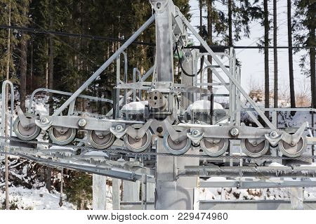 Close-up View Of The Chairlift Mechanism With Metallic Hawser And Rotating Tackles