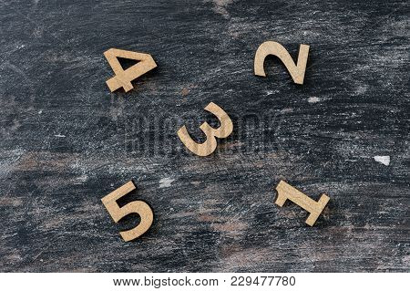 Numbers 1, 2, 3 4 5 On A Dark Vintage Wooden Background