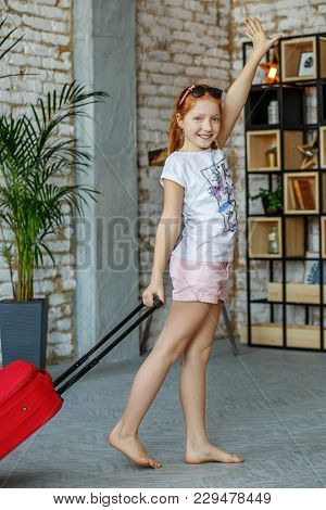 Little Happy Girl Gathered For A Trip. Concept, Lifestyle, Childhood, Trip, Vacation, Family, Touris