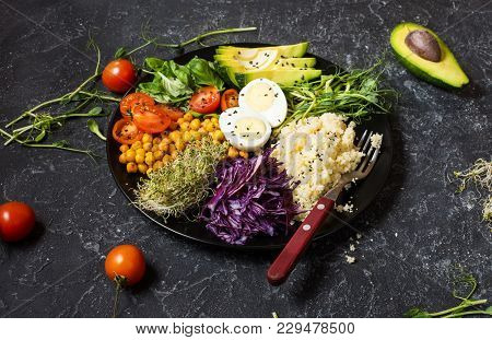 Healthy Vegan Lunch Bowl. Vegan Buddha Bowl. Vegetables And Nuts In Buddha Bowl On Black Concrete Ba