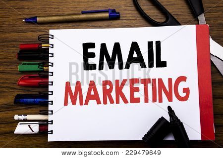 Handwritten Text Showing Email Marketing. Business Concept For Online Web Promotion Written On Noteb