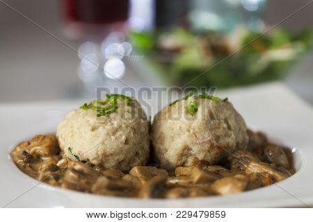 Closeup Of Bread Dumpling With Mushroom Sauce