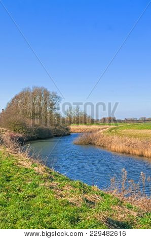 Steep Banked River In Winter, River Idle West Stockwith Nottinghamshire