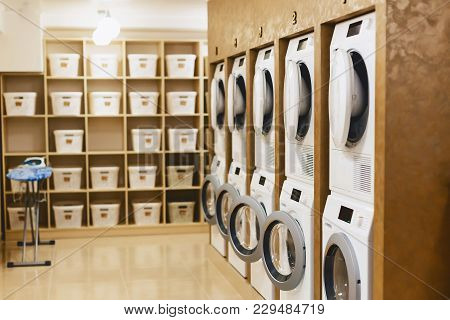 Laundry Room With Driers And Dryers With Shells