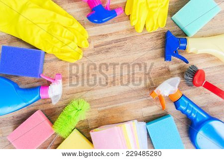 Spring Cleaning Concept - Colorful Sprays Botles And Rubbers Flat Lay Frame
