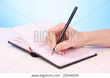 Woman writting hand with pencil