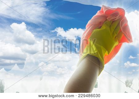 Spring Cleaning - Someones Hand In Yellow Gloves With Ruber Cleaning Window, Spring Bright Blue Sky