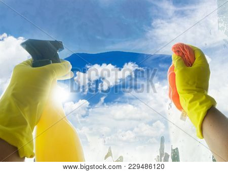 Spring Cleaning - Someones Hands In Yellow Gloves With Spray And Ruber Cleaning Window, Spring Brigh