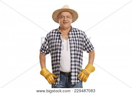 Elderly farmer looking at the camera and smiling isolated on white background