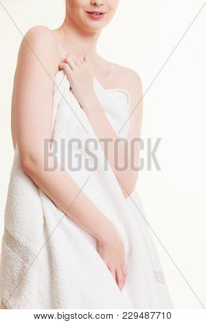 Beauty Of Female Body. Naked Woman Covering Herself With White Bath Towel. Attractive Lady In Spa Ma